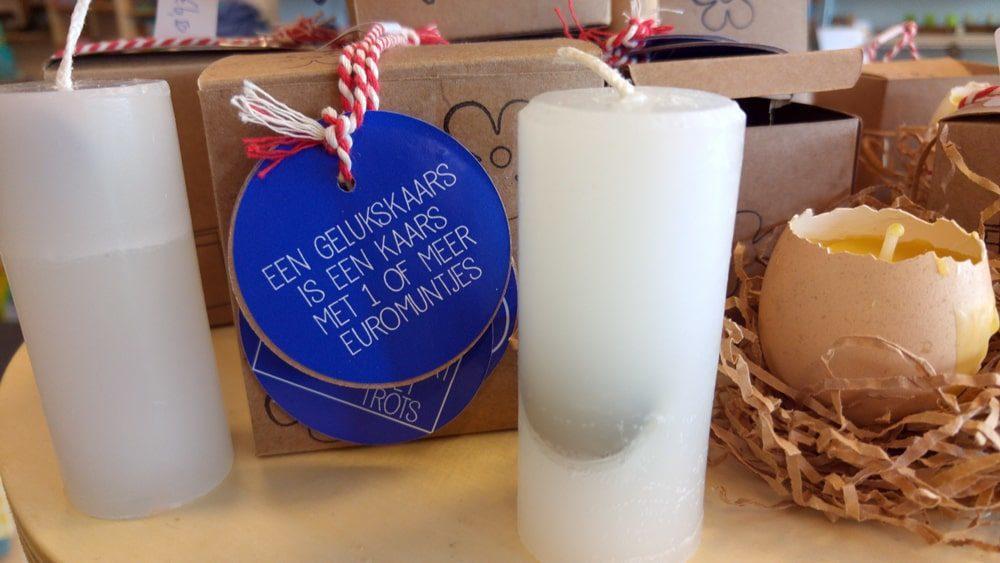 Kaarsen met euromunten erin van Cadeaus Met Een Missie